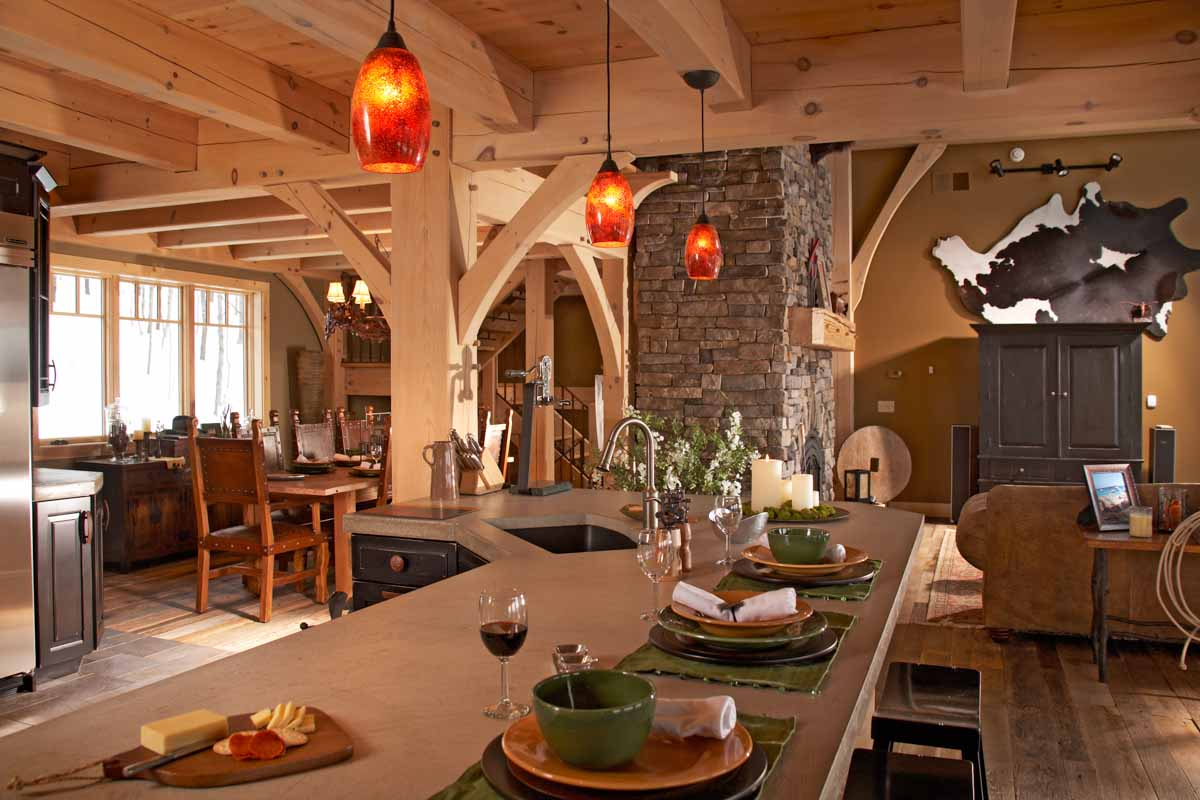 Kitchen with pendant lights hanging from timber joist