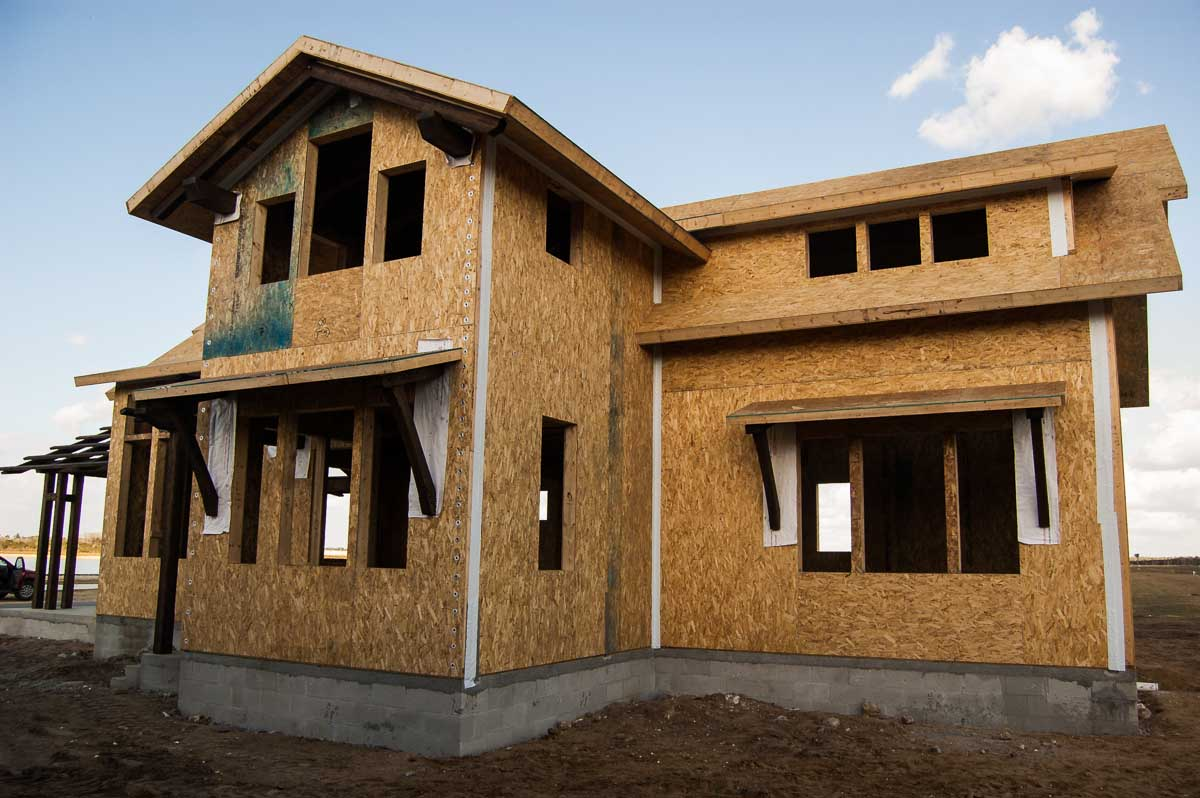 timber home design. Partially constructed cabin timber home with structural insulated panels  skinned sheets of OSB for Timber Frame Home Designs Cabin Timberbuilt