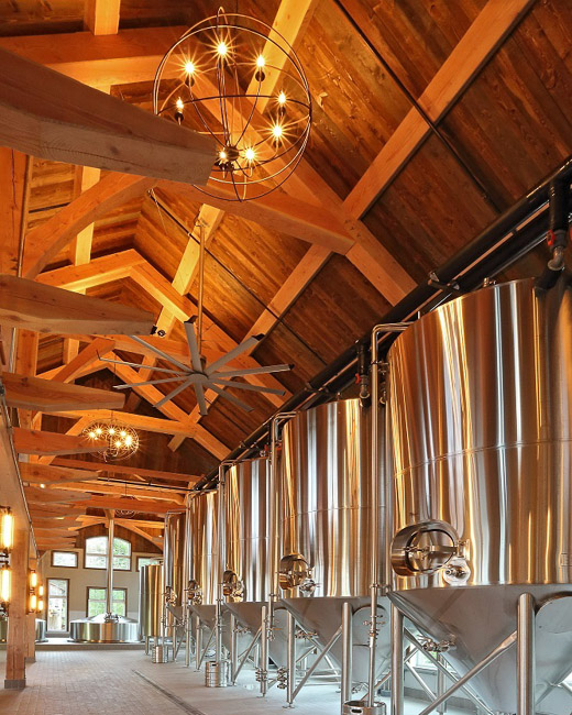 Massive timber and tongue-and-groove ceiling over brewery equipment
