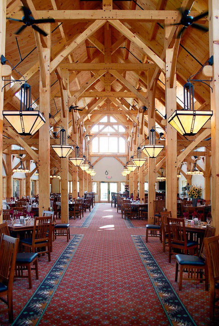 Country clib dining room with timber rafters over dining tables that fill the large room