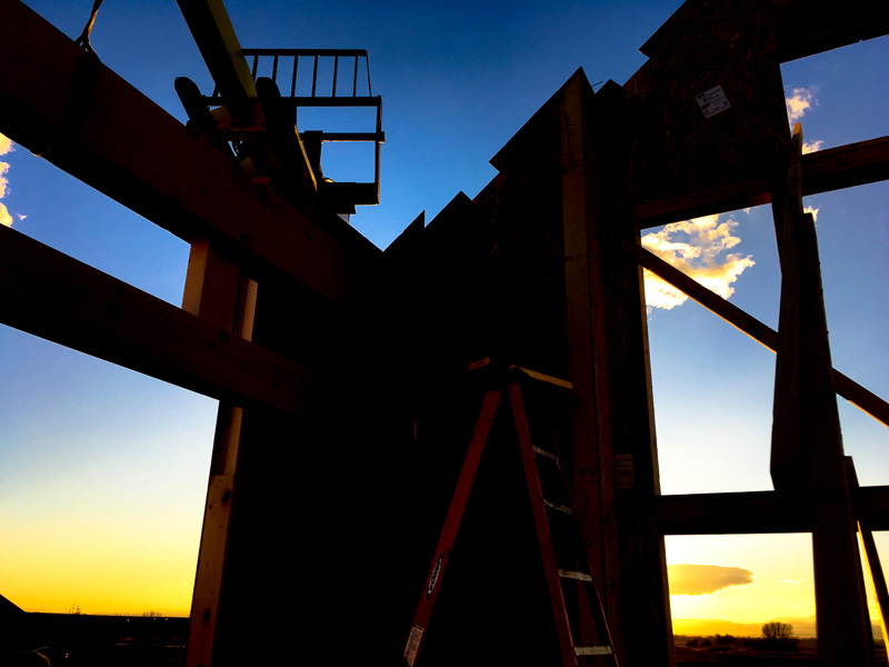 pocked SIP panels backlit by colorado sunset