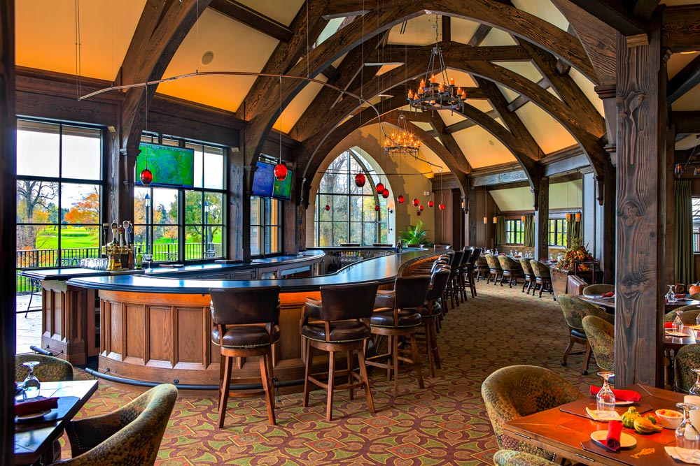 golf clubhouse with curved timber frame details in the ceiling over the bar and lounge