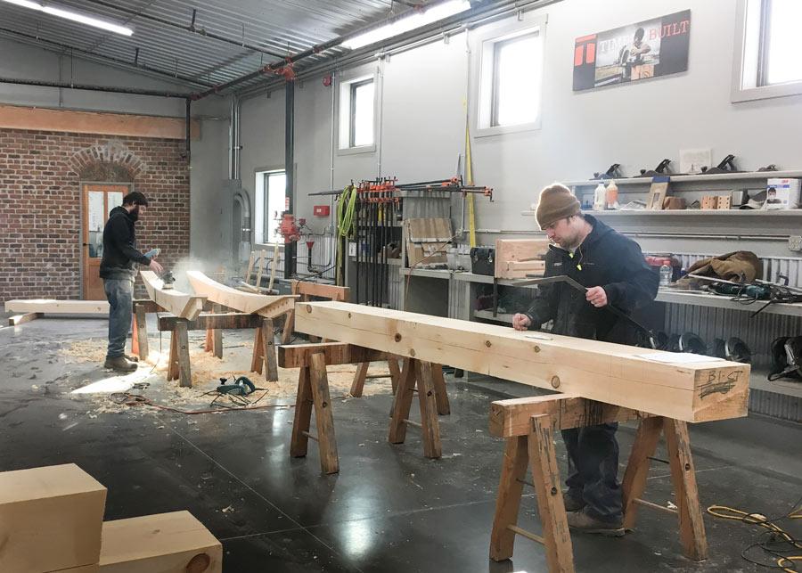 timber framers cut joinery at Timberbuilt shop
