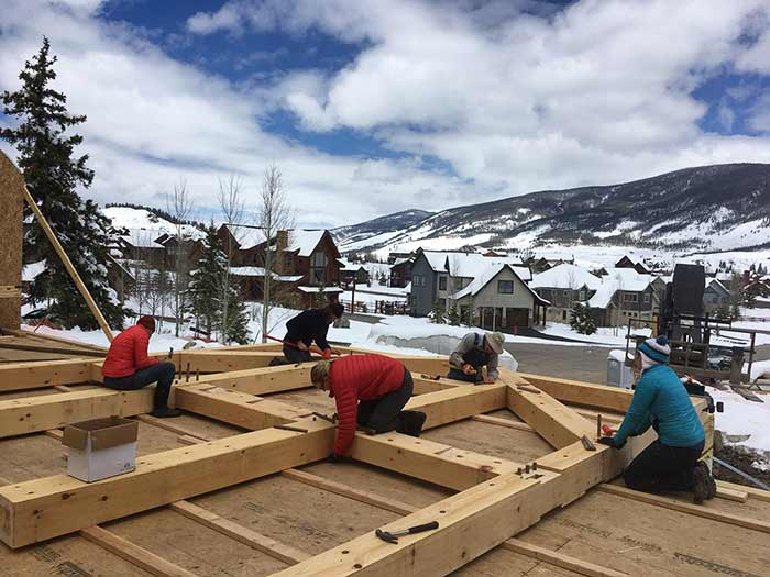 Diy timber frame we come we teach you build timberbuilt family members working together on a timber bent solutioingenieria Choice Image